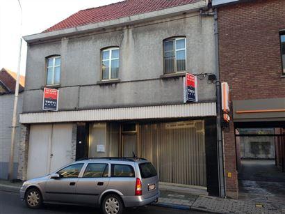 Winkel met privéwoning